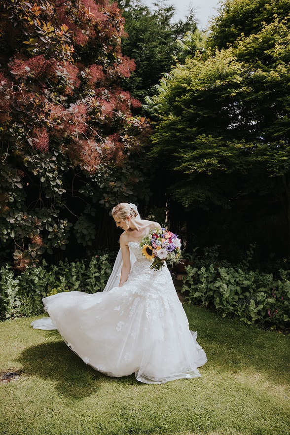 Beautiful bride on her wedding day wearing an Ian Stuart dress