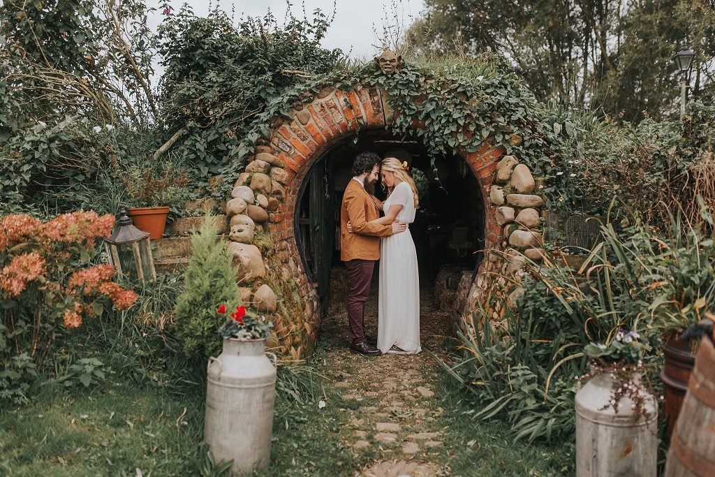 Bride and groom by the Hobbit Hole at Skipbridge Country Weddings