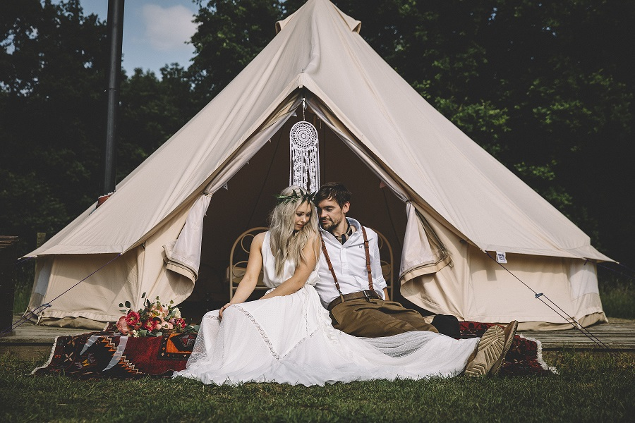 Bride and groom in front of their wedding bell tent at Camp Katur