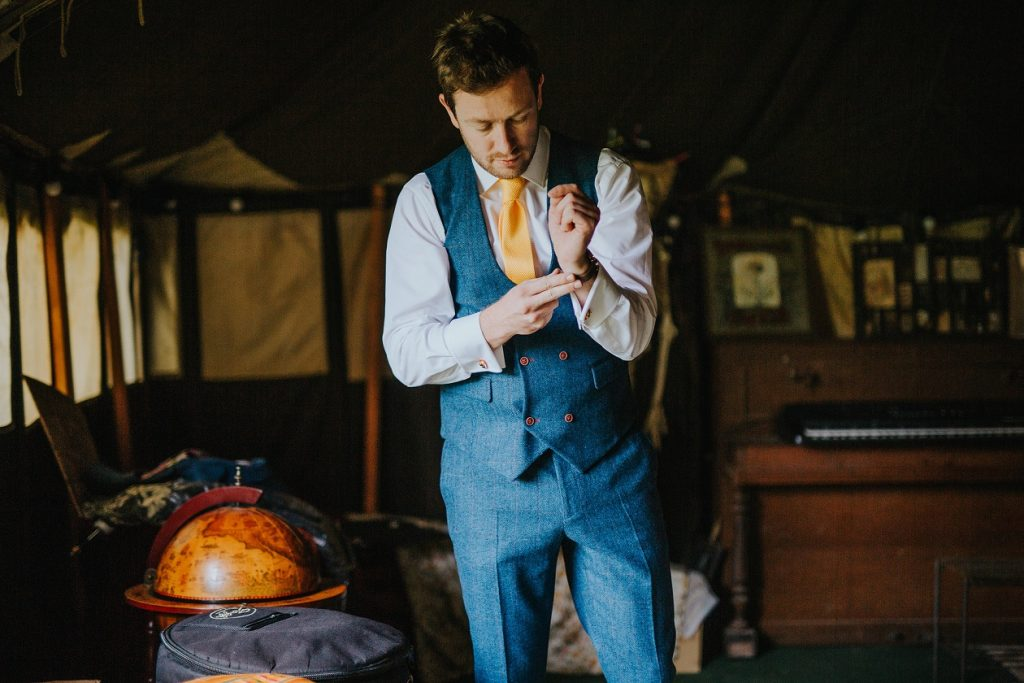 Groom getting ready for his outdoor wedding in Leeds, West Yorkshire