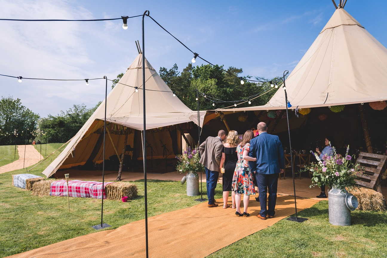 Guests arriving at a teepee wedding reception in Stirton, Skipton