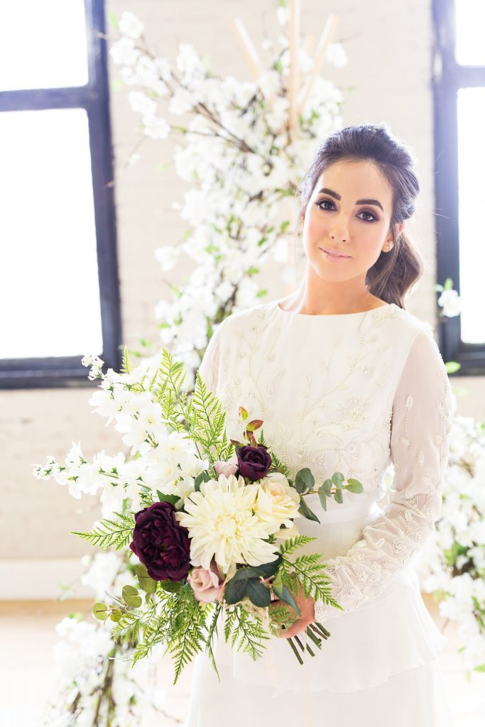 Bohemian bride with a faux flower bouquet from Deluxe Blooms