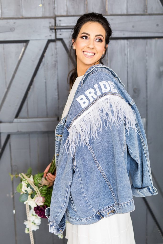 Edgy bohemian bride with Beespoke denim jacket
