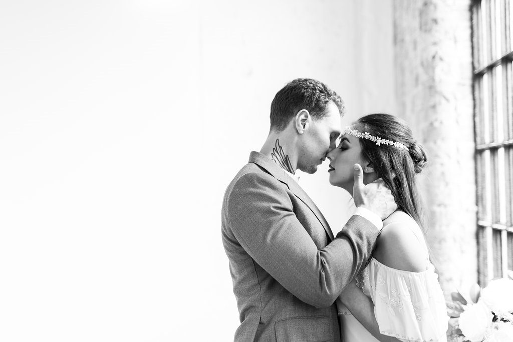 Romantic image of bride and groom in black and white